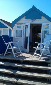 Beach Hut, decking & chairs.
